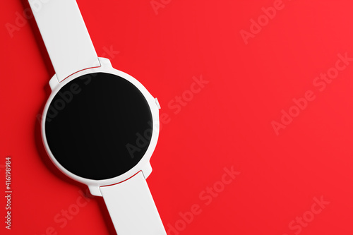 3d illustration white wrist watch with round black dial on red isolated background