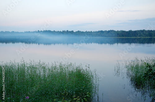 The nature of Seliger. Evening landscape with fog on Lake Glubokoe in the Tver region, Russia © koromelena