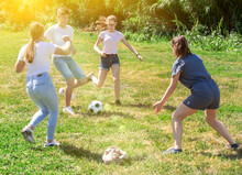 Cheerful Teen Friends Gaily Spending Time Together On Summer Day, Playing With Ball Outdoors