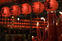 Jieyun Temple, New Taipei City, Taiwan - February 12, 2021: Red Candle Against The Traditional Chinese Red Lanterns In The Night.