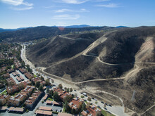 A Charred Hillside Where A Wildfire Was Stopped Short Of A Neighborhood Below