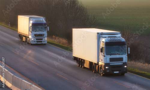 Truck with container on highway, cargo transportation concept. © TTstudio