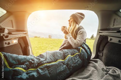 Obraz na plátně Girl resting in her car, journey made by car