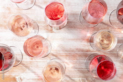 Wine design template. Various glasses of wine forming a frame for copy space, overhead flat lay shot © laplateresca