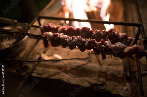 Fototapeta Meat with smoke on the barbecue grill