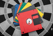 Colorful Collage Of Floppy Disks On Dartboard - Data Concept