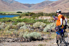 Cycling Idaho Wilderness With Sagebrush And Lake