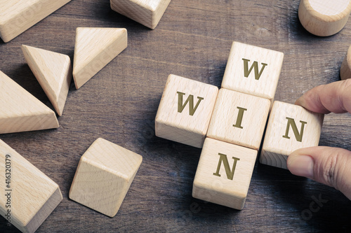 Win-Win Wood Blocks on the Table, Joint Venture concept © patpitchaya