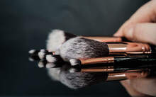 Professional Make Up Brush Set Isolated On Black Mirror Surface Background With Reflection