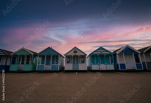 Obraz na plátně A row of colourful beach huts at dawn on the coast of Suffolk, UK