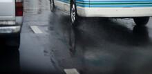 Water Splash From Wheel On Wet Road After City Rain