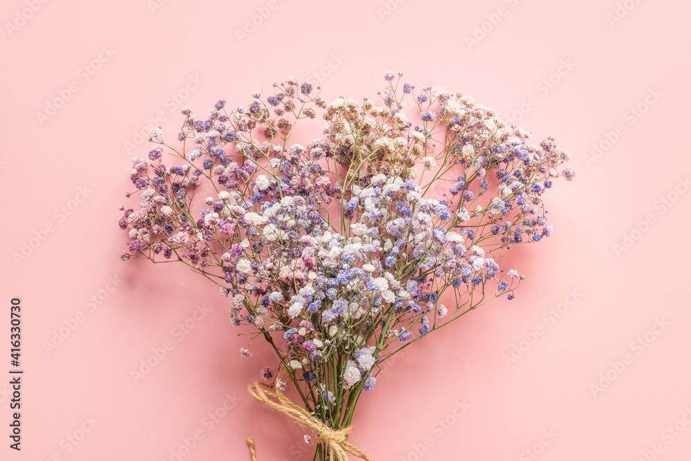 Fototapeta Bouquet of blue gypsophila on pink background. Floral pattern.