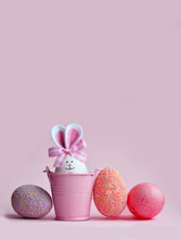Easter Holiday Concept With Cute Handmade Eggs, Bucket And Bunny Ears.