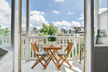 Gorgeous View Of The Street From Balcony With A Tea Table