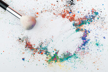 Makeup Brushes On Background With Colorful Powder. Make-up Background