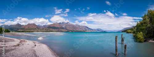 Canvas Print Mountain View and wooden piers at Kinloch, an unspoiled and remote touristic site located where Dart river is flowing into the Northern end of Lake Wakatipu in Otago Region, New Zealand, South Island