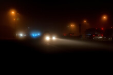 Cars White Headight In The Fog And Yellow Lantern Light