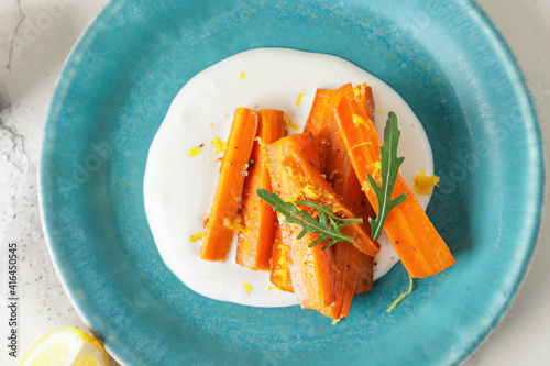 Plate of tasty baked carrot, closeup