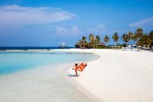 Woman On A Beautiful Sandy Beach, Maldives