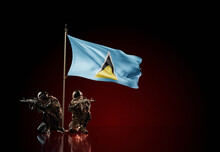 Concept Of Military Conflict. Waving National Flag Of Saint Lucia. Two Soldier Statue Guards Defending The Symbol Of Country Against Red Wall