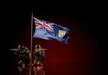 Concept Of Military Conflict. Waving National Flag Of Anguilla. Two Soldier Statue Guards Defending The Symbol Of Country Against Red Wall