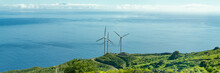 Three Wind Turbines On The Coast Of The Canary Island Of La Palma, Spain, In The Background The Atlantic Ocean