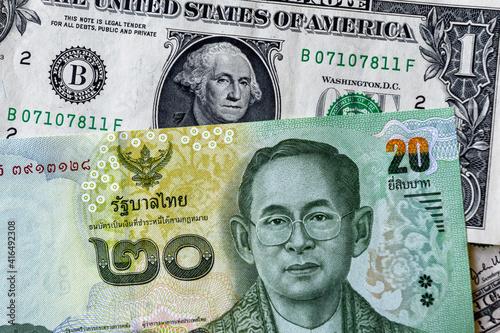 Fototapeta Business concept. Thai baht 20 banknote against american dollar