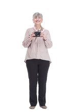 Happy Old Lady With A Camera In Her Hands. Isolated On A White Background.
