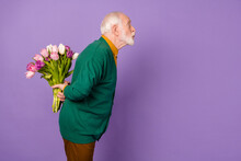 Profile Photo Of Handsome Man Kiss Look Empty Space Hold Flowers Behind Back Isolated On Violet Color Background