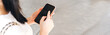 Woman hand holding a smart phone at outdoor and touching text a message chat.