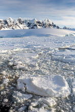Snow-covered Mountains And Dense Sea Ice In Neumayer Channel, Palmer Archipelago, Antarctica, Polar Regions