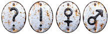 Set Of Symbols Question Mark, Exclamation Point, Female, Male Made Of Forged Metal On The Background Fragment Of A Metal Surface With Cracked Rust.