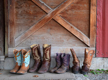 Cowboy Boots Lined Up At A Stable, Merritt, British Columbia, Canada, North America