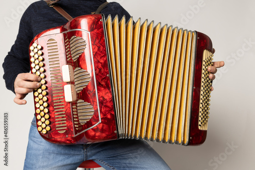 Obraz na plátne young man playing accordion on the white background