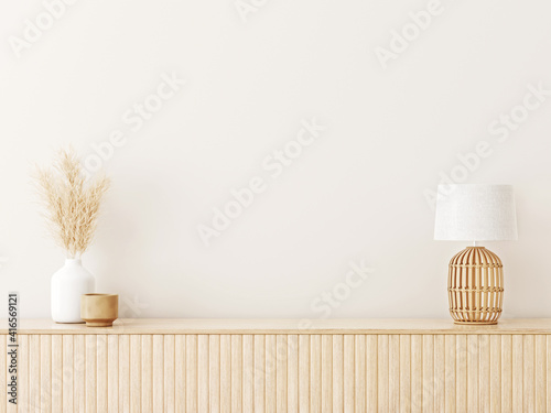 Fototapeta Interior wall mockup in minimalist Japandi style with light biege wooden console, dried pampas grass and wicker basket lamp on empty warm white background