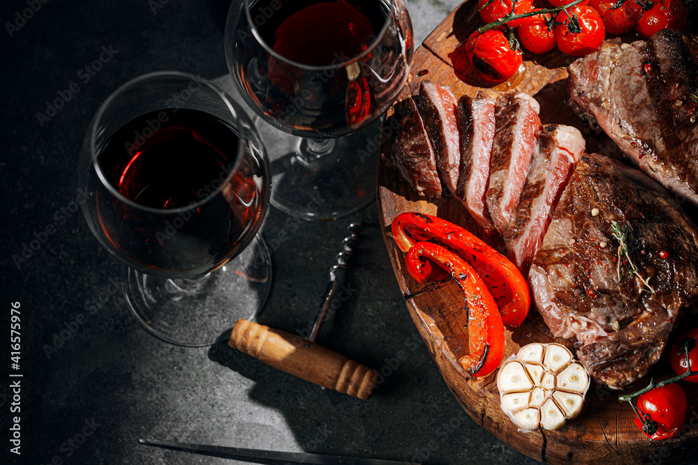Fototapeta dinner for two with steaks and red wine