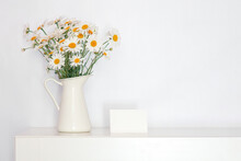 A Bouquet Of Wild Flowers In A White Vase On The Table, Retro Style, Chamomile In A White Interior, Background For Mom's Day, Free Space