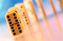Group Of Dominoes On An Early-colored Blurred Soft Background.