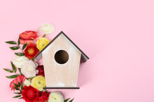 Stylish Bird House And Fresh Flowers On Pink Background, Flat Lay. Space For Text