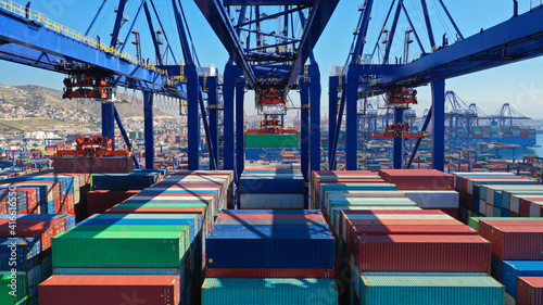 Canvas Print Aerial closeup photo of colourful container seaside port and logistics terminal