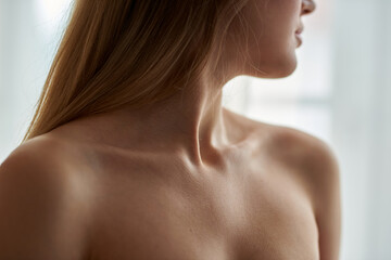 View on woman's neck, collarbone, breast and shoulders, close-up