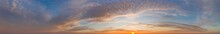 Intense Dramatic Panoramic Sunset With Cirrus Clouds Illuminated By Golden Rays Of The Sun
