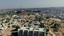 The Nigerian Town Of Jos On A Hazy Day - Aerial Pull Back View