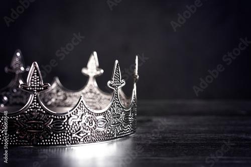 Fototapeta Silver Metal King or Queens Crown on a black Wood Table