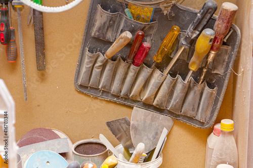 Fototapeta Toolkit full of screwdrivers hangs on the wall in the workshop obraz na płótnie