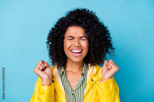 Obraz na płótnie Portrait of delighted dark skin person closed eyes fists up celebrate unexpected