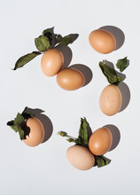 2021 Easter Real Unique Still Life Composition. Eggs With Dry Natural Leaves. Flat Lay Minimal Background.