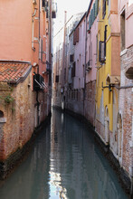 Water In The Canal In Venice Near Buildings In Italy During Quarantine During The Day Without Peopl