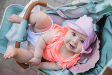 Charming Newborn Baby Girl In Blue Baby Carriage