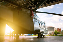 Passenger Helicopter In The Hangar. Rotorcraft Under Maintenance. Checking Mechanical Systems For Flight Operations